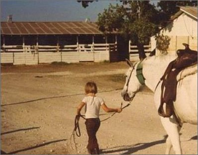 A young John Ross Palmer with his horse, Blu.